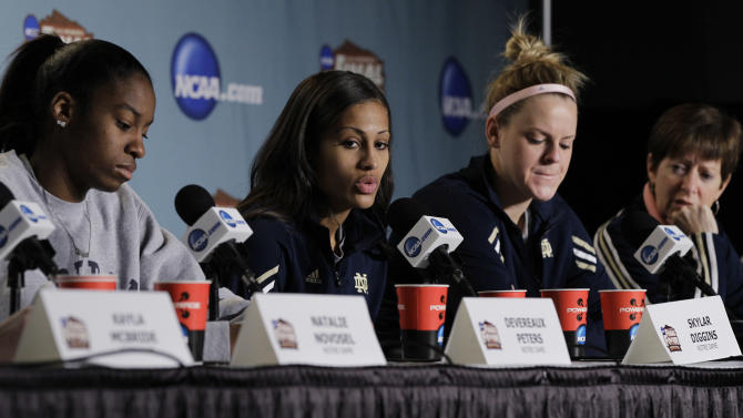 Notre Dame's Skylar Diggins, second from left, answers a question during an NCAA Women's Final Four news conference,  Monday, April 2, 2012, in Denver. Notre Dame will face Baylor in the finals Tuesday.  Also pictured are Notre Dame's Devereaux Peters, left, Brittany Mallory, second from right, and coach Muffet McGraw, right. (AP Photo/Eric Gay)