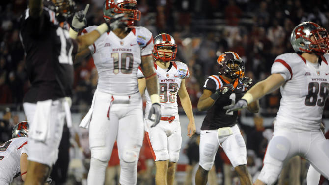 CORRECTS TO BORGESE'S FIELD GOAL-ATTEMPT NOT FULLER'S - Virginia Tech cornerbacks Kyle Fuller (17) and Antone Exum (1) look on as Rutgers kicker Nick Borgese (93) and tight ends D.C. Jefferson (10) and Paul Carrezola (89) react while watching Borgese's field goal-attempt go wide right in overtime at an NCAA college football Russell Athletic Bowl game on Friday, Dec. 28, 2012, in Orlando, Fla. Virginia Tech won 13-10. (AP Photo/Brian Blanco)