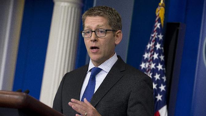 White House press secretary Jay Carney gestures during the daily press briefing at the White House in Washington, Monday, June 24, 2013. Carney said the U.S. assumes that Edward Snowden is now in Russia and that the White House now expects Russian authorities to look at all the options available to them to expel Snowden to face charges in the U.S. for releasing secret surveillance information . (AP Photo/Evan Vucci)
