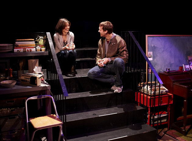 "In this theater image released by The O and M Co., Susan Pourfar, left, and Russell Harvard are shown in a scene from the play ""Tribes"" by Nina Raine at Barrow Street Theatre in New York. (AP Photo/The O and M Co., Gregory Costanzo)"