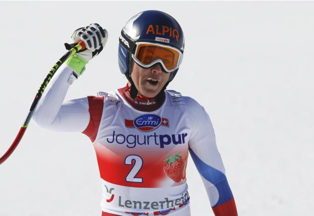 Aufdenblatten of Switzerland reacts after her career's last race in the women's downhill event during the FIS Alpine Skiing World Cup finals in the Swiss ski resort of Lenzerheide