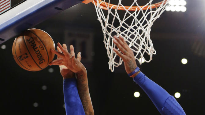 Boston Celtics forward Paul Pierce (34) knocks the ball from the hands of New York Knicks forward Carmelo Anthony (7) in the first half of their NBA basketball game at Madison Square Garden in New York, Monday, Jan. 7, 2013. (AP Photo/Kathy Willens)