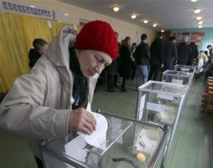 A woman casts her ballot during the referendum on the …