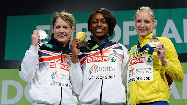 Britain's Perri Shakes-Drayton (C) celebrates winning the women's 400m final on the podium with 2nd place Britain's Eilidh Child (L) and 3rd place Sweden's Moa Hjelmer at the European Indoor Championships in Gothenburg (AFP)