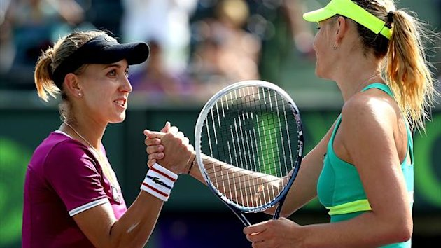 Elena Vesnina of Russia congratulates Maria Sharapova of Russia after their match during the Sony Open
