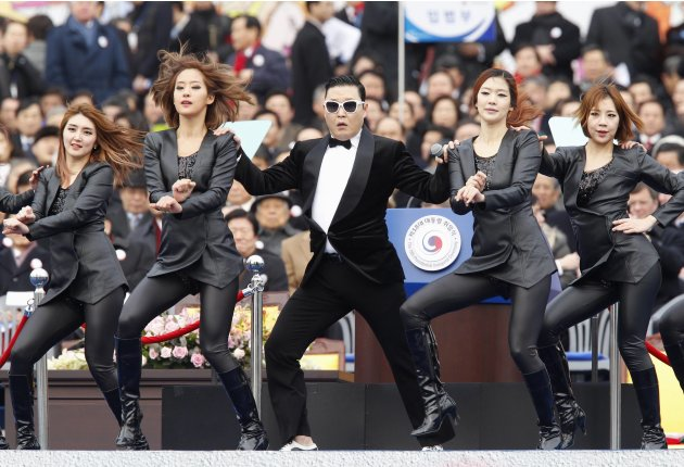 Singer Psy performs during the inauguration of South Korea's President Park at parliament in Seoul