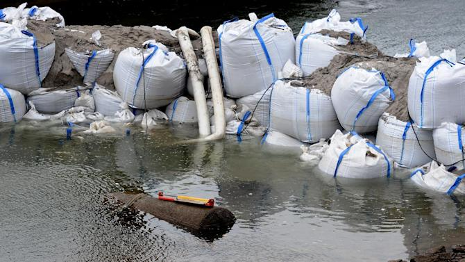 Sandbags frame a 1.8 ton WWII bomb  in river Rhine near Koblenz Saturday Dec. 3, 2011. Officials in Germany's western city of Koblenz say some 45,000 residents have to be evacuated because of a World War II era bomb discovered in the Rhine river. The bomb was discovered in the Rhine after its water level fell significantly amid a prolonged lack of rain. (AP Photo/dapd/ Harald Tittel)
