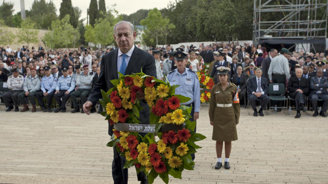 Israeli Prime Minister Benjamin Netanyahu lays a wreath during the annual ceremony in memory of six million Jews who perished in the Nazi holocaust, on Holocaust Remembrance Day at Yad Vashem memorial in Jerusalem,Thursday, April 19, 2012. Israel is marking its annual remembrance day for the six million Jews killed by the Nazis in World War II. (AP Photo/Ariel Schalit, Pool)