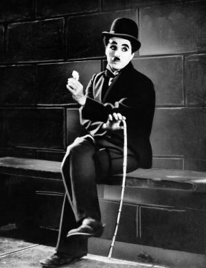"FILE - In this 1931 film image originally released by United Artists, actor Charlie Chaplin is seen in the silent film ""City Lights.""  A new musical ""Chaplin,"" depicting the life of film icon Charlie Chaplin, will open on Broadway on Monday, Sept. 10, 2012 at the Barrymore Theatre in New York. (AP Photo, file)"