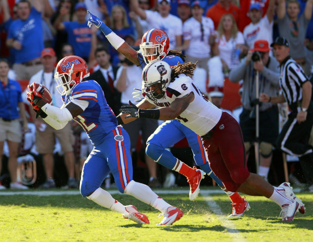 Florida&amp;#39;s Chris Johnson, left, runs the ball to the 1-yard line in front of South Carolina&amp;#39;s Justice Cunningham, right, after recovering a fumble on a kickoff during the first half of an NCAA 