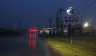 Isaac's rain and winds buffeted the streets of Waveland, Miss., Wednesday, Aug. 29, 2012, the seventh anniversary of Hurricane Katrina hitting the Gulf Coast. Isaac was packing 80 mph winds, making it a Category 1 hurricane. It came ashore early Tuesday near the mouth of the Mississippi River, driving a wall of water nearly 11 feet high inland and soaking a neck of land that stretches into the Gulf. The storm stalled for several hours before resuming a slow trek inland, and forecasters said that was in keeping with the its erratic history. The slow motion over land means Isaac could be a major soaker, dumping up to 20 inches of rain in some areas. (AP Photo/Rogelio V. Solis)