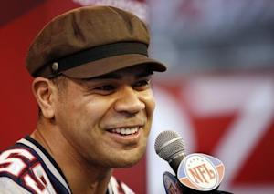 New England Patriots' Seau answers questions during media day for NFL's Super Bowl XLII in Glendale