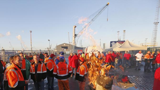 Workers block an entrance of the port of Antwerp