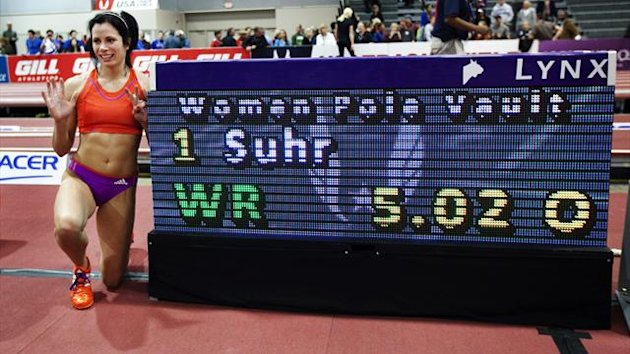 Jenn Suhr poses next to the score board after setting a new women's indoor pole vault world record of 5.02 metres (16 feet 5 1/2 inches) at the USA Indoor Track and Field Championships in Albuquerque, New Mexico (Reuters)