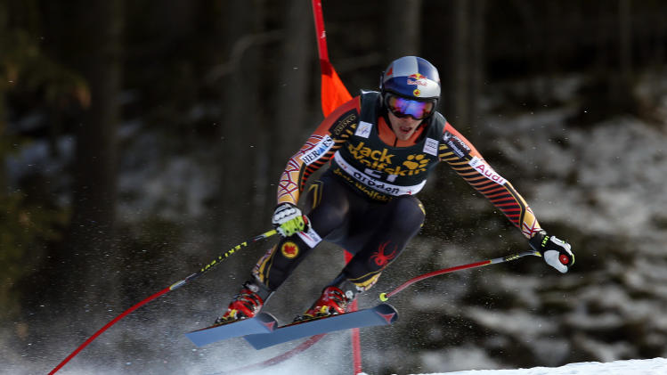 Canada's Erik Guay is airborne on his way to win an alpine ski, men's World Cup downhill, in Val Gardena, Italy, Saturday, Dec. 21, 2013. (AP Photo/Marco Trovati)