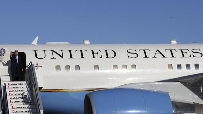 US Secretary of State John Kerry waves farewell after attending meetings in Sydney, Australia, on August 13, 2014