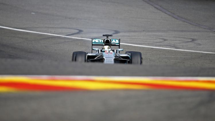 Hamilton steers his car during the first practice session at the Belgian F1 Grand Prix in Spa-Francorchamps