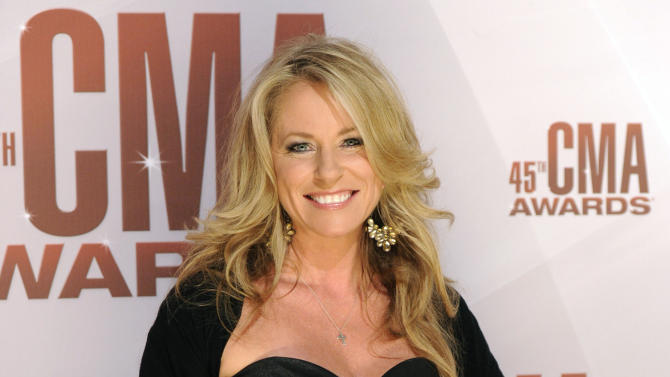 FILE - In this Nov. 9, 2011 file photo, Deana Carter arrives at the 45th Annual CMA Awards in Nashville. Court records show Carter filed for separation from her husband Brandon Malone in Los Angeles on Tuesday, Nov. 13, 2012. The couple were married in October 2009, but separated in August 2011, according to Carter's filing citing irreconcilable differences. (AP Photo/Evan Agostini, File)