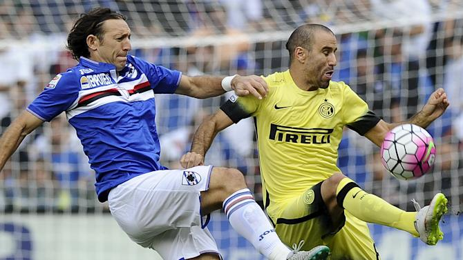 Sampdoria's Barreto challenges Inter Milan's Palacio during their Italian Serie A soccer match at the Marassi stadium in Genoa