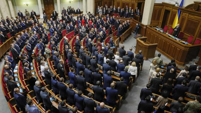 Newly elected parliamentary deputies sing the national anthem during the first session of the new Ukrainian parliament, which was elected in October, in Kiev