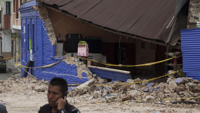 Yellow taped is draped in front of a home damaged in a magnitude 7.4 earthquake that struck in San Marcos, Guatemala, Wednesday, Nov. 7, 2012. The mountain village, some 80 miles (130 kilometers) from the epicenter, suffered much of the damage with some 30 homes collapsing in its center. There are three confirmed dead and many missing after the strongest earthquake to hit Guatemala since a deadly 1976 quake that killed 23,000. (AP Photo/Moises Castillo)