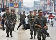 Philippine sodliers patrol the streets of the southern city of Zamboanga in 2002. Philippine security forces rescued a Chinese hostage and killed five Islamic militants Friday during a raid on the mountainous outskirts of Zamboanga