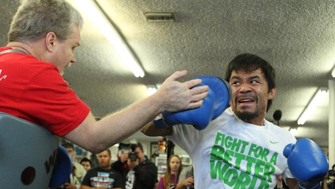 Manny Pacquiao (R) working out with his trainer Freddie Roach on April 2, 2014 in Hollywood