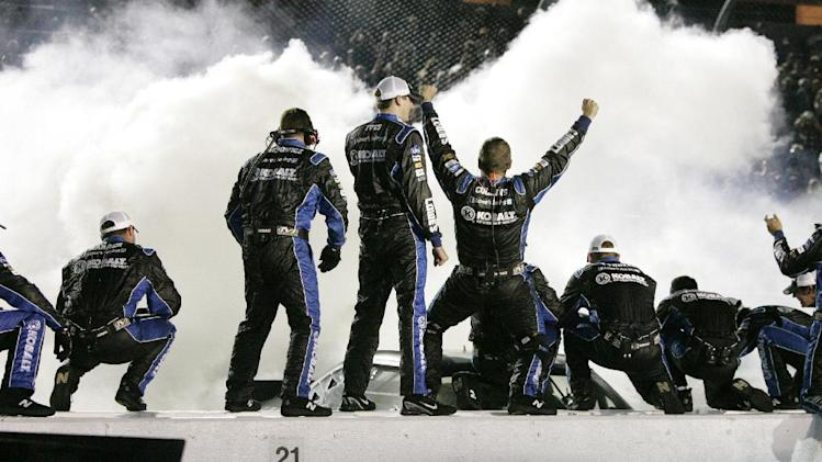 Jimmie Johnson's pit crew celebrates their win at the NASCAR Sprint Cup Series auto race at Darlington Raceway, Saturday, May 12, 2012, in Darlington, S.C. (AP Photo/Mary Ann Chastain)