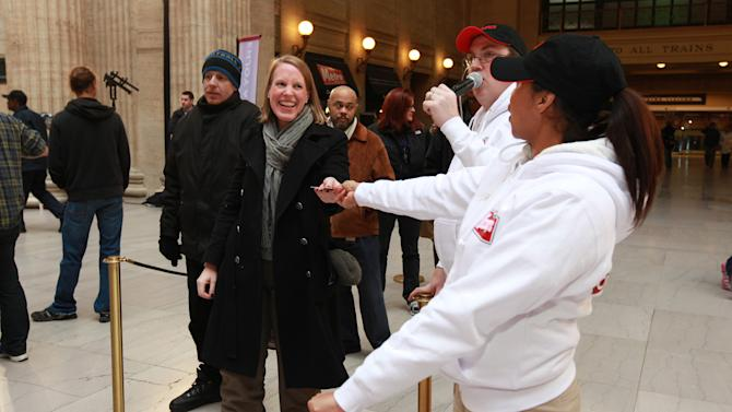 Consumer receives Wendy's gift card for participation in Wendy's ClaimYourTaste.com event at Union Station, on Tuesday, Jan. 15, 2013 in Chicago. (Photo by Barry Brecheisen/Invision for Wendy's/AP Images)