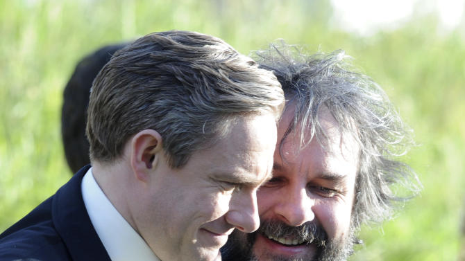"Cast member Martin Freeman, left, embraces director Peter Jackson at the premiere of ""The Hobbit: An Unexpected Journey,""  at the Embassy Theatre, in Wellington, New Zealand, Wednesday, Nov. 28, 2012.  (AP Photo/SNPA, Ross Setford) NEW ZEALAND OUT"