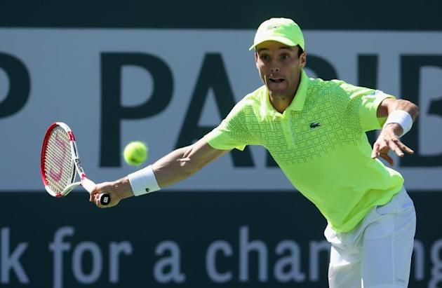 Roberto Bautista Agut of Spain returns a forehand to Tomas Berdych of the Czech Republic during the BNP Paribas Open at Indian Wells Tennis Garden on March 9, 2014 in Indian Wells, California