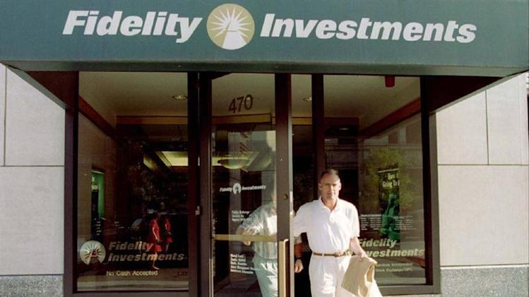 Customers leave a sales office of Fidelity Investments in Boston, August 27. Fidelity announced that..