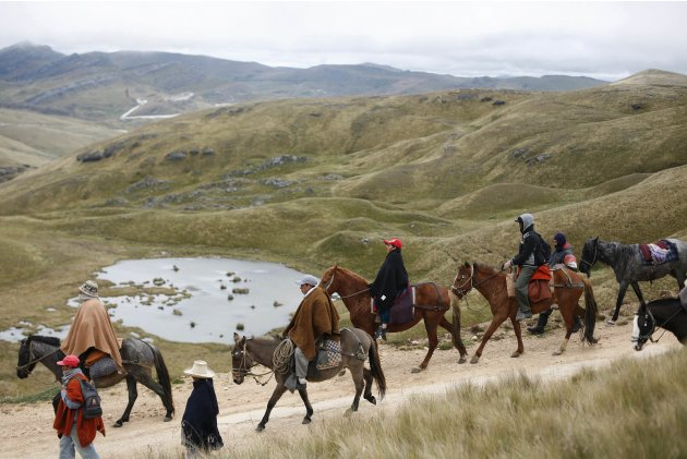 Andean people take part in a protest march against Newmont Mining's Conga project, along the Chica lagoon in Cajamarca