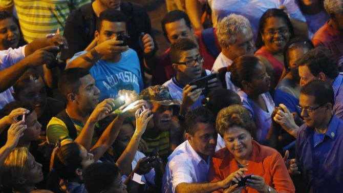 Brazil's President and Workers Party (PT) presidential candidate Dilma Rousseff  greets supporters during a campaign rally in Rio de Janeiro