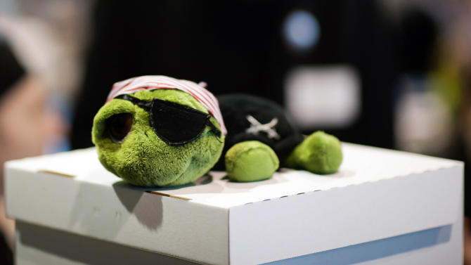 A toy turtle dressed as a pirate lies on top of a ballot box during a party convention of the Pirates in Neumuenster, northern Germany, Saturday, April 28, 2012. Pirates are capturing Germany's political system: The party started as a marginal club of computer nerds and hackers, but its appeal as an anti-establishment movement has lured many young voters to the ballot boxes, gaining it parliamentary seats in two consecutive state elections. (AP Photo/dapd, Clemens Bilan)