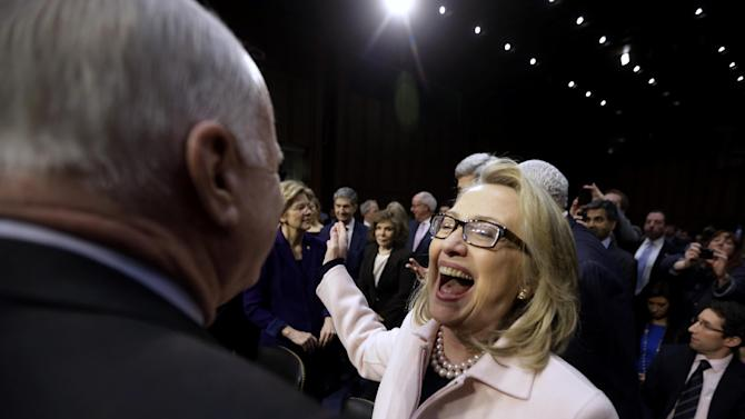 Secretary of State Hillary Rodham Clinton, right, reacts to seeing Senate Foreign Relations Committee member Sen. John McCain, R-Ariz., left, on Capitol Hill in Washington, Thursday, Jan. 24, 2013, prior to the start of the committee's confirmation hearing for Senate Foreign Relations Chairman Sen. John Kerry, D-Mass. to replace Clinton as secretary of state.  (AP Photo/Pablo Martinez Monsivais)
