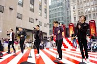 FILE - In this Tuesday, Nov. 13, 2012 file photo, One Direction members, from left, Niall Horan, Liam Payne, Zayn Malik, Louis Tomlinson and Harry Styles perform on NBC&#39;s &quot;Today&quot; show in New York. On Nov. 13, 2012, One Direction released its sophomore album, Take Me Home, which comes eight months after the boy band dropped its debut, Up All Night, which debuted at No. 1 and is platinum. (Photo by Charles Sykes/Invision/AP, File)