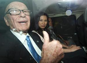 News Corporation Chief Executive and Chairman, Rupert Murdoch, gestures as he leaves after giving evidence for the second day at the Leveson Inquiry at the High Court in London