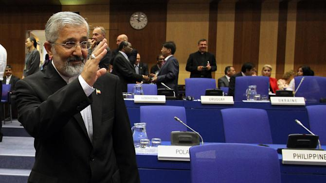 Ali Asghar Soltanieh, Iran's ambassador to the International Atomic Energy Agency (IAEA), waves as he arrives for the IAEA board of governors meeting in Vienna, Austria, Monday, Sept. 10, 2012. (AP Photo/Ronald Zak)