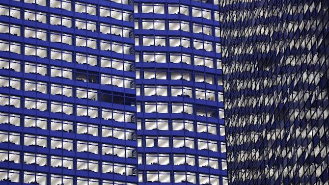 "FILE - In this Tuesday, Jan. 15, 2013, photo, the lights are on at Goldman Sachs"" headquarters, in New York. The Goldman Sachs Group Inc. reports quarterly financial results before the market opens on Tuesday, April 16, 2013. (AP Photo/Mark Lennihan)"