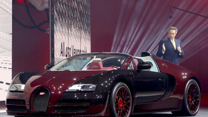 Bugatti CEO Durheimer speaks next to the Bugatti Veyron Grand Sport Vitesse 'La Finale' during a Volkswagen Group event ahead of the 85th International Motor Show in Geneva