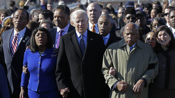 Vice President Joe Biden, center, leads a group across the Edmund Pettus Bridge in Selma, Ala., Sunday, March 3, 2013. They were commemorating the 48th anniversary of Bloody Sunday, when police officers beat marchers when they crossed the bridge on a march from Selma to Montgomery. From left: Selma Mayor George Evans, U.S. Rep. Terri Sewell, D-Ala., Rev. Jesse Jackson, Biden, Rev. Al Sharpton and U.S. Rep. John Lewis, D-Ga. (AP Photo/Dave Martin)