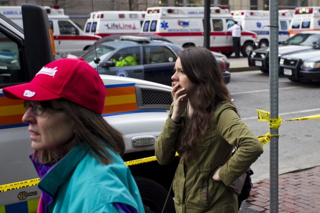 A woman reacts at the scene after explosions reportedly interrupted the running of the 117th Boston Marathon in Boston