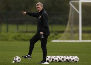 Manchester United's manager Moyes gestures during a training session in Manchester