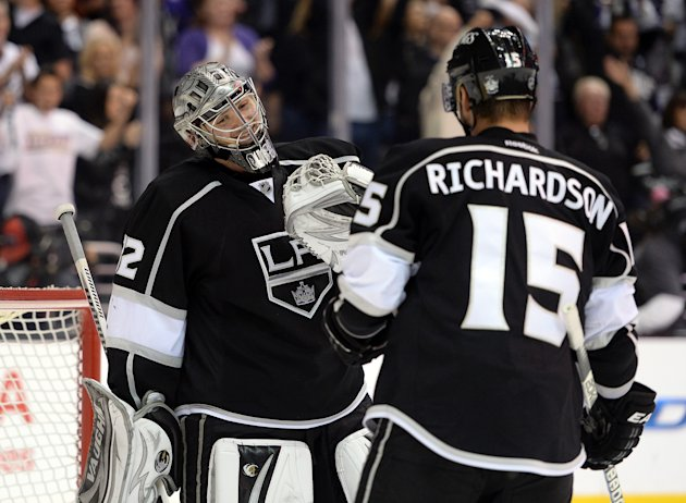 LOS ANGELES, CA - MAY 23:  Jonathan Quick #32 of the Los Angeles Kings celebrates a 3-0 shutout win over the San Jose Sharks with Brad Richardson #15 to take a 3-2 series lead in Game Five of the Western Conference Semifinals during the 2013 Stanley Cup Playoffs at Staples Center on May 23, 2013 in Los Angeles, California.  (Photo by Harry How/Getty Images)