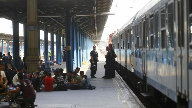 Migrants sit on a platform of the Keleti railway station in Budapest