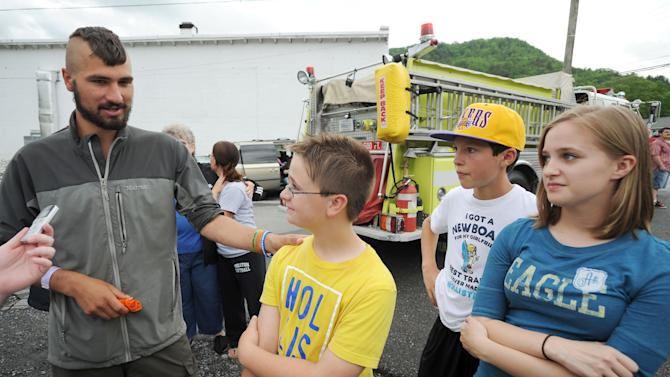 """Hiker """"Quinoa"""" talks about being given credit for saving the lives of Carson Balckburn, Dalton Thomason, and Faith Ritchie after he ran them and others off the road with a water gun during a festival parade in Damascus, Va., Saturday, May 18, 2013. Just as the children ran off the street, a car came down the road and struck several people. (AP Photo/Bristol Herald Courier, Earl Neikirk)"""