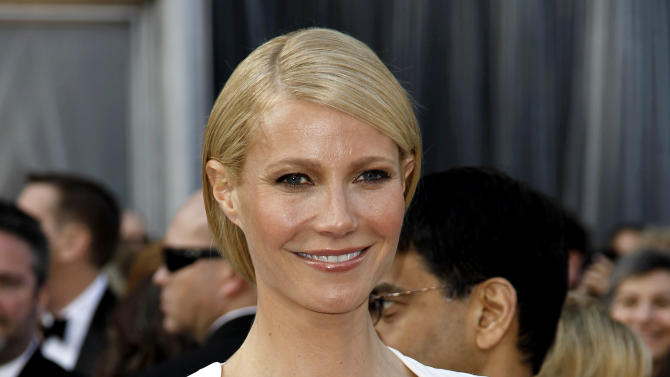 FILE - This Feb. 26, 2012 file photo shows actress Gwyneth Paltrow at the 84th Academy Awards in the Hollywood section of Los Angeles. Paltrow, Julia Roberts, Matt Damon, Samuel L. Jackson and Emma Stone are among the stars participating in the third Stand Up to Cancer telethon, the organization announced Wednesday, Aug. 22. (AP Photo/Matt Sayles, file)
