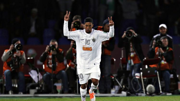 Atletico Mineiro's Ronaldinho celebrates and dances after his goal against Raja Casablanca during their FIFA Club World Cup semi-final match at Marrakech stadium