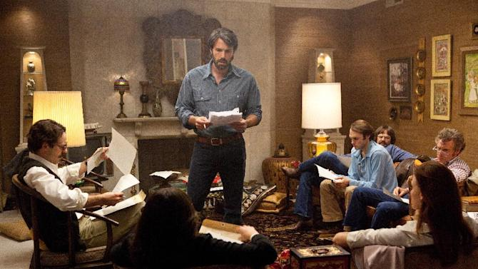 """This film image released by Warner Bros. Pictures shows Ben Affleck as Tony Mendez, center, in """"Argo,""""  a rescue thriller about the 1979 Iranian hostage crisis.  (AP Photo/Warner Bros., Claire Folger)"""